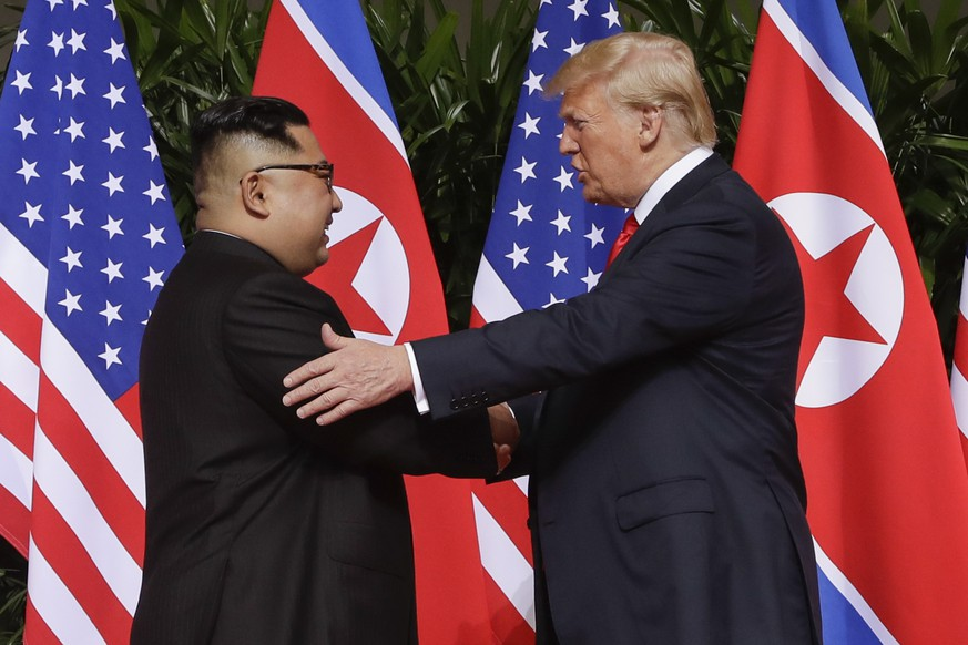 FILE - In this June 12, 2018, file photo, U.S. President Donald Trump shakes hands with North Korea leader Kim Jong Un at the Capella resort on Sentosa Island, in Singapore.  (AP Photo/Evan Vucci, File)