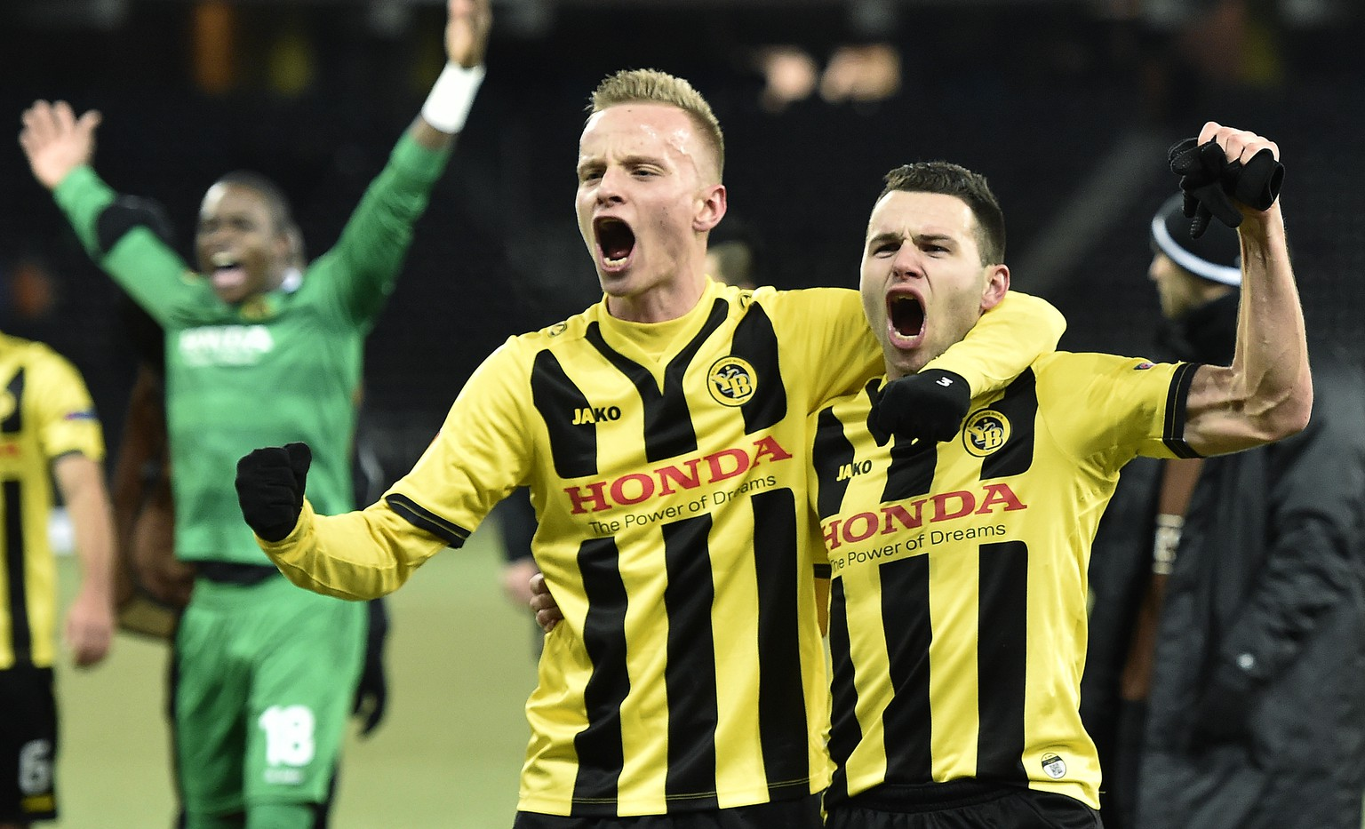 YB's Florent Hadergjonaj, left, and Renato Steffen celebrate their victory during their Europa League Group I stage match between Switzerland's Young Boys Bern and Czech Republic's AC Sparta Praha at the Stade de Suisse Stadium in Bern, Switzerland, Thursday, December 11, 2014. (KEYSTONE/Peter Schneider)