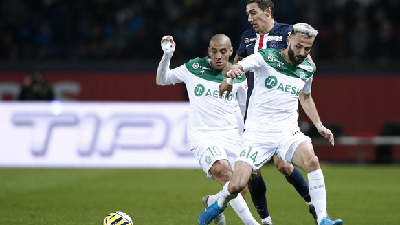 epa08113161 Paris Saint Germain's Angel Di Maria (C), Saint-Etienne's Wahbi Khazri (L) and Saint-Etienne's Franck Honorat (R) in action during the French Ligue Cup quarter final soccer match between PSG and Saint-Etienne at the Parc des Princes stadium in Paris, France, 08 January 2020.  EPA/YOAN VALAT