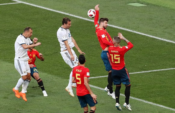 epa06855092 The ball hits the arm of Gerard Pique of Spain which results in a penalty during the FIFA World Cup 2018 round of 16 soccer match between Spain and Russia in Moscow, Russia, 01 July 2018.  (RESTRICTIONS APPLY: Editorial Use Only, not used in association with any commercial entity - Images must not be used in any form of alert service or push service of any kind including via mobile alert services, downloads to mobile devices or MMS messaging - Images must appear as still images and must not emulate match action video footage - No alteration is made to, and no text or image is superimposed over, any published image which: (a) intentionally obscures or removes a sponsor identification image; or (b) adds or overlays the commercial identification of any third party which is not officially associated with the FIFA World Cup)  EPA/ABEDIN TAHERKENAREH   EDITORIAL USE ONLY