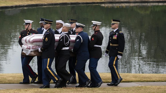 The flag-draped casket of former President George H.W. Bush is carried to a burial plot close to his presidential library for internment on Thursday, Dec. 6, 2018, in College Station, Texas. (Smiley N. Pool/The Dallas Morning News via AP, Pool)