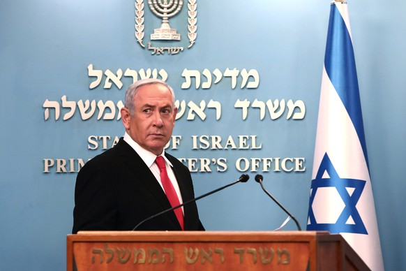 epa08294783 Israeli Prime Minister Benjamin Netanyahu gives a speech regarding the new measures that will be taken to fight the Corona virus in Israel, at his Jerusalem office, 14 March 2020. Netanyahu said Israel would shut down eateries, shopping centres and gyms in a bid to halt the spread of coronavirus. Netanyahu also said he would ask the government's approval in the upcoming cabinet meeting set to be held via video conference to allow