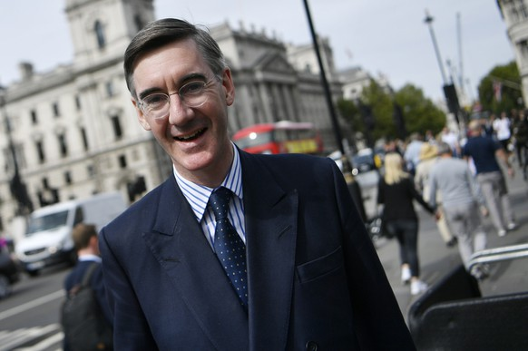 epa07010763 Conservative MP Jacob Rees-Mogg arrives at the Palace of Westminster in London, Britain, 10 September 2018.  EPA/NEIL HALL