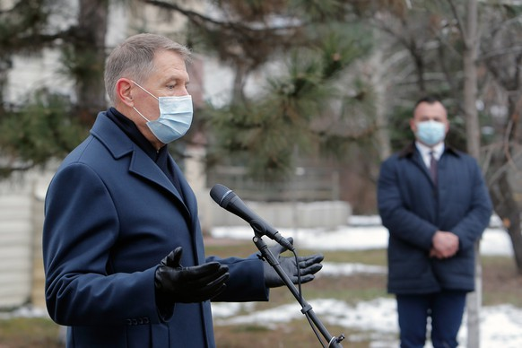 epa08972877 Romania's President Klaus Iohannis gestures during a press statement at the 'Matei Bals' Covid-19 hospital in Bucharest, Romania, 29 January 2021. A fire broke out early this morning at a pavilion of the 'Matei Bals' Hospital in the Romanian capital. Five people have died and 11 are reported injured as a result of the fire at the Institute of Infectious Diseases 'Matei Bals' as 120 patients with COVID-19 were transferred to other hospitals.  EPA/BOGDAN CRISTEL