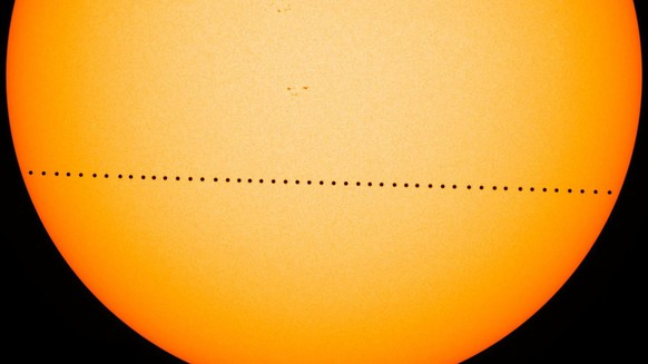In this composite image provided by NASA, the planet Mercury passes directly between the sun and Earth on May 9, 2016 in a transit which lasted seven-and-a-half-hours. On Monday, Nov. 11, 2019, Mercury will make another transit, visible from the eastern U.S. and Canada, and all Central and South America. The rest of North America, Europe and Africa will catch part of the action. Asia and Australia will miss out. (NASA's Goddard Space Flight Center/SDO/Genna Duberstein via AP)