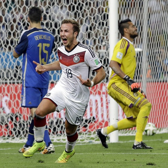 FILE - In this July 13, 2014 file photo, Germany's Mario Goetze celebrates after scoring the opening goal past Argentina's goalkeeper Sergio Romero during the World Cup final soccer match between Germany and Argentina at the Maracana Stadium in Rio de Janeiro, Brazil. Mario Goetze, Leroy Sane and Mauro Icardi have each achieved plenty in their careers but they won't be achieving anything at the upcoming World Cup as they belong to a group of elite players left off otheir national team squads. (AP Photo/Victor R. Caivano, File)