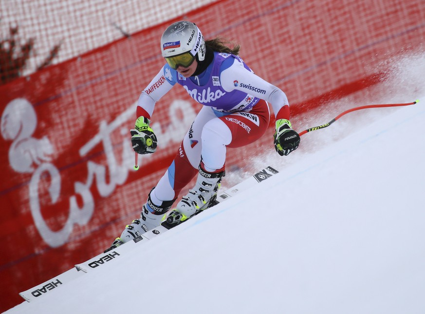 Switzerland's Corinne Suter speeds down the course during a training session for ski World Cup women's downhill, in Cortina d'Ampezzo, Italy, Thursday, Jan. 17, 2019. (AP Photo/Marco Trovati)