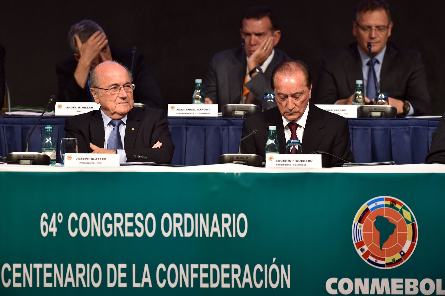 FIFA's President Joseph Blatter (L) and Conmebol's president Eugenio Figueredo Aguerre (R) attend the 64th Ordinary Congress of Conmebol in Sao Paulo, Brazil on June 9, 2014.  AFP PHOTO / NELSON ALMEIDA