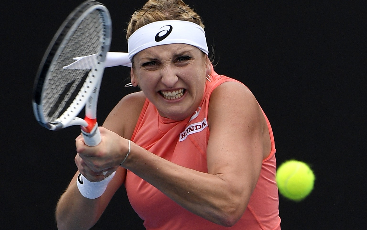 Switzerland's Timea Bacsinszky makes a backhand return to Russia's Daria Kasatkina against during their first round match at the Australian Open tennis championships in Melbourne, Australia, Tuesday, Jan. 15, 2019. (AP Photo/Andy Brownbill)