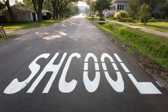 A street near Northwood Elementary in Kalamazoo, Mich., has the word school misspelled on the pavement Wednesday, Sept. 5, 2007.  Crews were expected to correct the mistake Thursday.  (AP Photo/Kalamazoo Gazette, Jill McLane Baker)