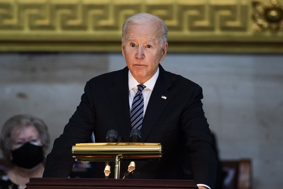 epa09133674 US President Joe Biden speaks during the service for U.S. Capitol Officer William ?Billy? Evans, as his remains lie in honor in the Capitol Rotunda in Washington, DC, USA, on 13 April 2021. Officer Evans was killed in the line of duty 02 April when a driver rammed his vehicle into Evans and another officer before crashing into a security barrier at the North entrance to the Capitol.  EPA/TOM WILLIAMS / POOL