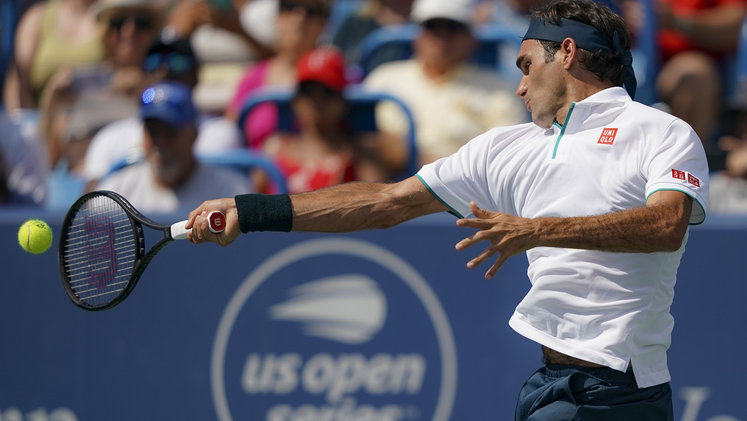 Roger Federer, of Switzerland, returns to Andrey Rublev, of Russa, during the quarterfinals of the Western & Southern Open tennis tournament, Thursday, Aug. 15, 2019, in Mason, Ohio. (AP Photo/John Minchillo) Roger Federer