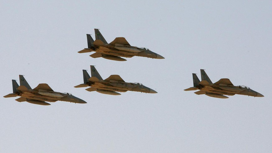 FILE - In this Sunday, Jan. 25, 2009 file photo, F-15 warplanes of the Saudi Air Force fly over the Saudi Arabian capital Riyadh during a graduation ceremony at King Faisal Air Force University. The Obama administration is expected to notify Congress on Wednesday, Oct. 20, 2010 of a multibillion-dollar sale of fighter jets and military helicopters to Saudi Arabia, including as many as 84 new F-15 fighter jets and three types of helicopters, officials said Tuesday, Oct. 19, 2010. (AP Photo/Hassan Ammar, File)