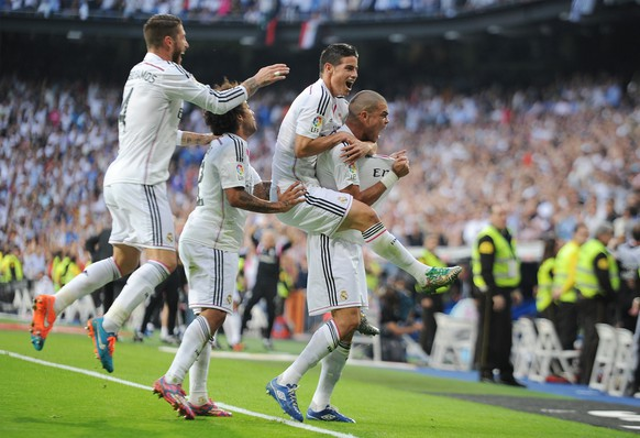 MADRID, SPAIN - OCTOBER 25:  Pepe of Real Madrid CF celebrates with James Rodriguez after scoring his team's 2nd goal from the penalty spot during the La Liga match between Real Madrid CF and FC Barcelona at Estadio Santiago Bernabeu on October 25, 2014 in Madrid, Spain.  (Photo by Denis Doyle/Getty Images)