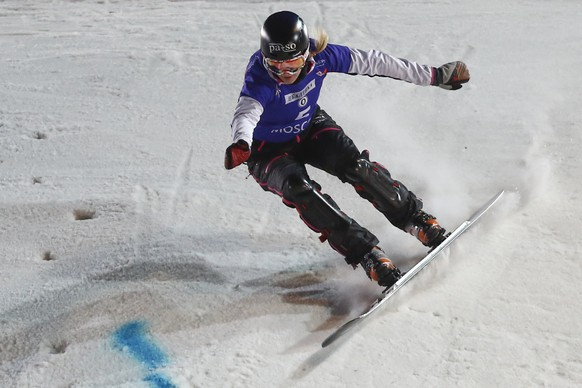 Switzerland's Patrizia Kummer competes at the women's parallel slalom at the Snowboard World Cup event in Moscow, Saturday, March 7, 2015. (AP Photo/Denis Tyrin)
