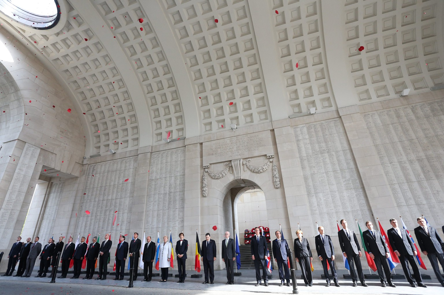 epa04283543 European heads of states attend a ceremony marking the centenary of the outbreak of World War I, in Ypres, Belgium, 26 June 2014. During the war, hundreds of thousands of soldiers and civilians from all over the world lost their lives around the Belgian town of Ypres. To mark the occasion, the European Union is donating a symbolic bench with bronzed copper plates reading the word 'Peace' in the EU's 24 official languages.  EPA/JULIEN WARNAND