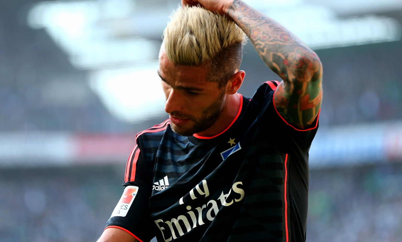 BREMEN, GERMANY - APRIL 19: Valon Behrami of Hamburg walks off dejected off the pitch during the Bundesliga match between SV Werder Bremen and Hamburger SV at Weserstadion on April 19, 2015 in Bremen, Germany.  (Photo by Martin Rose/Bongarts/Getty Images)