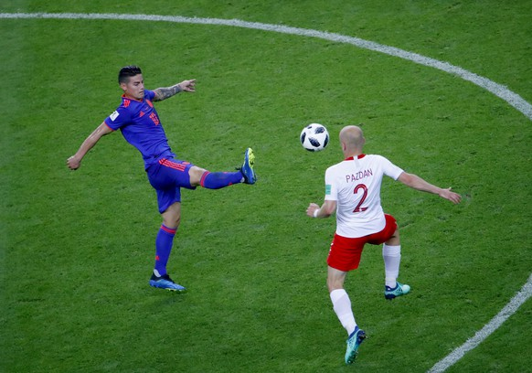 epa06837353 James Rodriguez of Colombia and Michal Pazdan of Poland in action during the FIFA World Cup 2018 group H preliminary round soccer match between Poland and Colombia in Kazan, Russia, 24 June 2018.  (RESTRICTIONS APPLY: Editorial Use Only, not used in association with any commercial entity - Images must not be used in any form of alert service or push service of any kind including via mobile alert services, downloads to mobile devices or MMS messaging - Images must appear as still images and must not emulate match action video footage - No alteration is made to, and no text or image is superimposed over, any published image which: (a) intentionally obscures or removes a sponsor identification image; or (b) adds or overlays the commercial identification of any third party which is not officially associated with the FIFA World Cup)  EPA/DIEGO AZUBEL   EDITORIAL USE ONLY