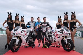 (L to R) French Damien Saulnier Team Manager of Suzuki junior Team, French pole vault champion Renaud Lavillenie and French motorcyclist Louis Rossi, pose with Playboy Bunnies, on September 19, 2014 in Le Mans, western France, during the presentation of the new logo of Le Mans 24 hours motorcycle race, on the race track after the qualifying session of the 37th endurance race. Fifty-five motorcycles with 165 riders will participate on September 20 and 21, 2014 in the Le Mans 24-hour endurance race.  AFP PHOTO / JEAN FRANCOIS MONIER