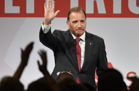 Prime minister and party leader of the Social Democrat party Stefan Löfven waves at an election party in Stockholm, Sweden, Sunday, Sept. 9, 2018. Preliminary results of the 2018 Swedish parliamentary elections showed on Sunday night that Centre-Left bloc of the Social Democratic Party, the Green Party and Left party gained 40.7 percent of votes, narrowly heading in the race. The opposition Center-Right alliance bloc of the Moderate Party, the Centre Party, the Liberal Party and the Christian Democrats gained 40.3 percent votes. Anti-immigration, the far-right Sweden Democrats scored 17.6 percent votes. (Jonas Ekströmer /TT via AP)