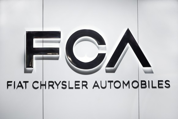 FILE - In this Monday, Jan. 14, 2019 file photo, Fiat Chrysler Automobiles FCA logo is shown at the North American International Auto Show in Detroit. Shares in Italian American automaker Fiat Chrysler have tanked Thursday, Feb. 7 after the company issued conservative earnings forecasts for 2019. Fiat Chrysler shares were temporarily suspended from trading due to excessive volatility, and then shed 11 percent in Milan. (AP Photo/Paul Sancya, file)