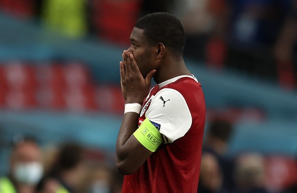 Austria's David Alaba reacts after losing the Euro 2020 soccer championship round of 16 match between Italy and Austria at Wembley stadium in London, Saturday, June 26, 2021. (Catherine Ivill/Pool via AP)