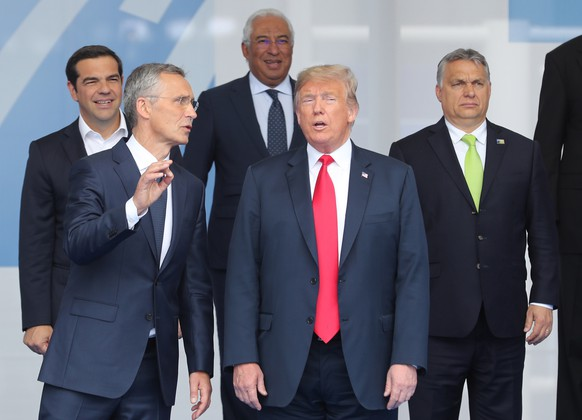 epa06880299 (L-R) Greek Prime Minister Alexis Tsipras, NATO Secretary General Jens Stoltenberg, Portugal's Prime Minister Antonio Costa, US President Donald J. Trump and Hungarian Prime Minister Viktor Orban together with other NATO heads of State and Government pose for a family picture during a NATO summit in Brussels, Belgium, 11 July 2018. NATO countries' heads of states and governments gather in Brussels for a two-day meeting.  EPA/OLIVIER HOSLET