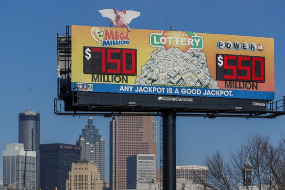 epa08935895 A billboard displays the Mega Millions (L) and Powerball (R) multi-state lottery jackpots  in Atlanta, Georgia, USA, 13 January 2021. The Mega Millions jackpot has grown to an estimated 750 million US dollars annuitized, or 550.6 million cash option for the next draw on 15 January 2021.  EPA/ERIK S. LESSER