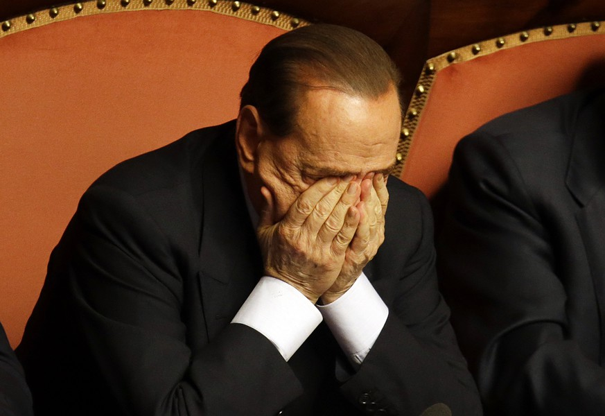 FILE - In this Wednesday, Oct. 2, 2013 file photo People of Freedom party leader Silvio Berlusconi rubs his eyes after delivering his speech at the Senate, in Rome. Italy's highest court was hearing Tuesday, March 10, 2015 what could be the final appeal in former Premier Silvio Berlusconi's infamous