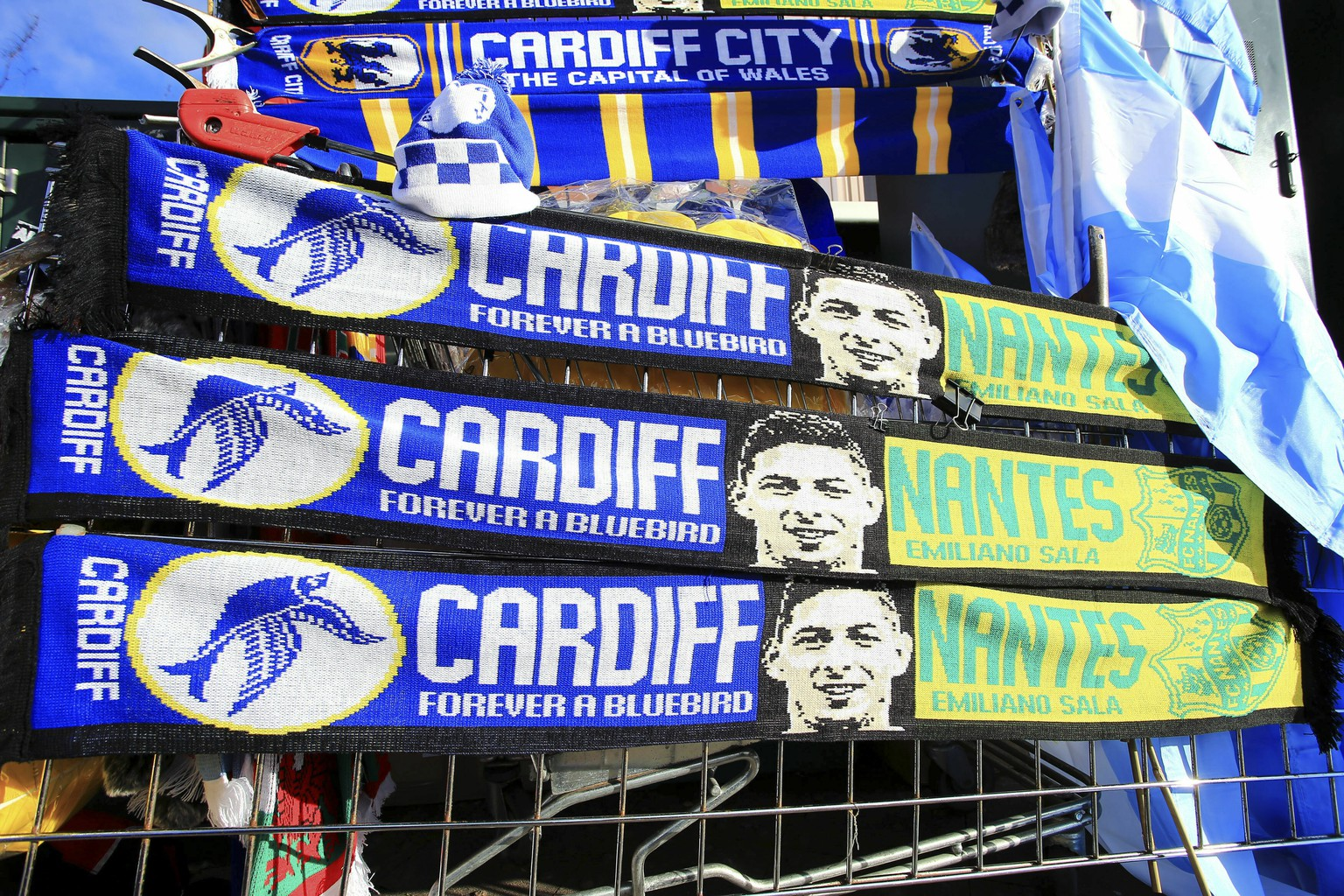 A view of scarves placed outside Cardiff City Stadium in tribute to Emiliano Sala, ahead of the English Premier League soccer match between Cardiff and Bournemouth at the Cardiff City Stadium, in Cardiff, Wales, Saturday, Feb. 2, 2019. (Mark Kerton/PA via AP)