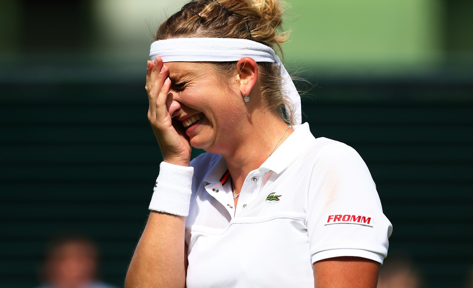 LONDON, ENGLAND - JULY 06:  Timea Bacsinszky of Switzerland shows her emotions after victory in her Ladies' Singles Fourth Round match against Monica Niculescu of Romania  during day seven of the Wimbledon Lawn Tennis Championships at the All England Lawn Tennis and Croquet Club on July 6, 2015 in London, England.  (Photo by Clive Brunskill/Getty Images)