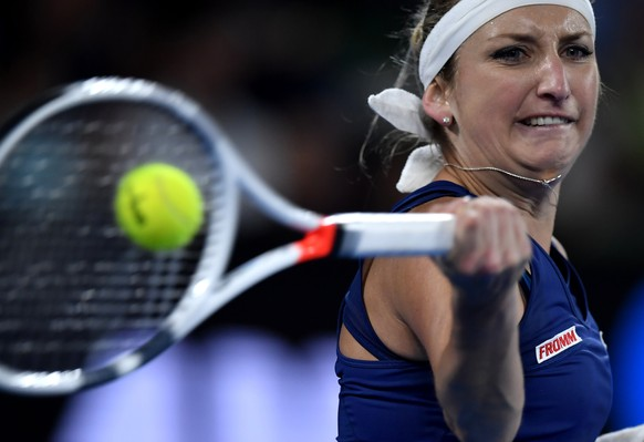 Switzerland's Timea Bacsinszky makes a forehand return to Australia's Daria Gavrilova during their third round match at the Australian Open tennis championships in Melbourne, Australia, Saturday, Jan. 21, 2017. (AP Photo/Andy Brownbill)