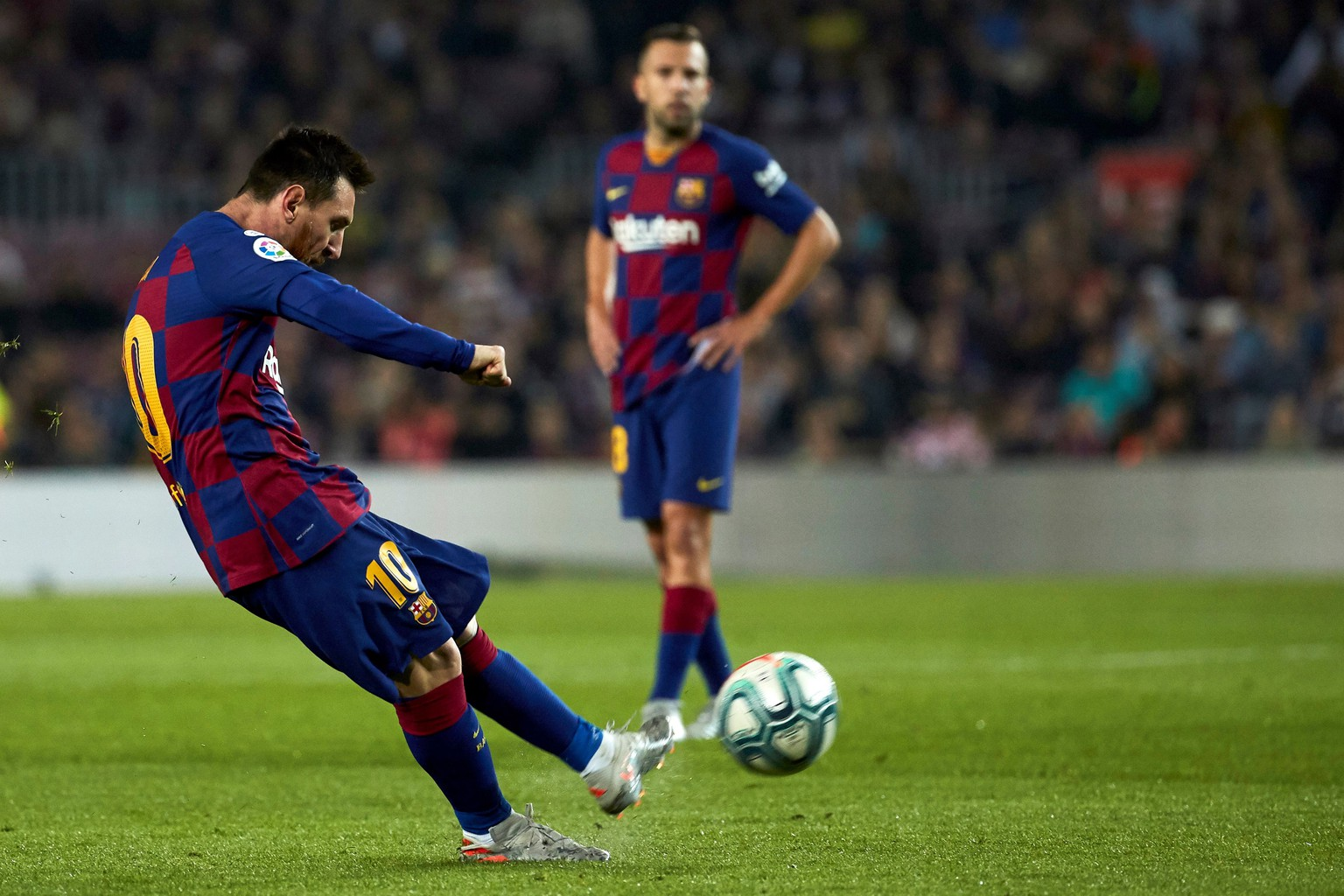 epa07958678 FC Barcelona's Lionel Messi shoots to score the 3-1 lead during a Spanish LaLiga soccer match between FC Barcelona and Real Valladolid at the Camp Nou stadium in Barcelona, Spain, 29 October 2019.  EPA/Alejandro Garcia