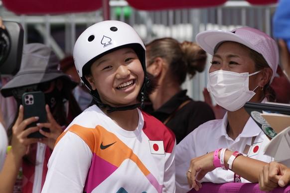 Gold medal winner Momiji Nishiya of Japan smiles after winning the women's street skateboarding finals at the 2020 Summer Olympics, Monday, July 26, 2021, in Tokyo, Japan. (AP Photo/Ben Curtis) Momiji Nishiya