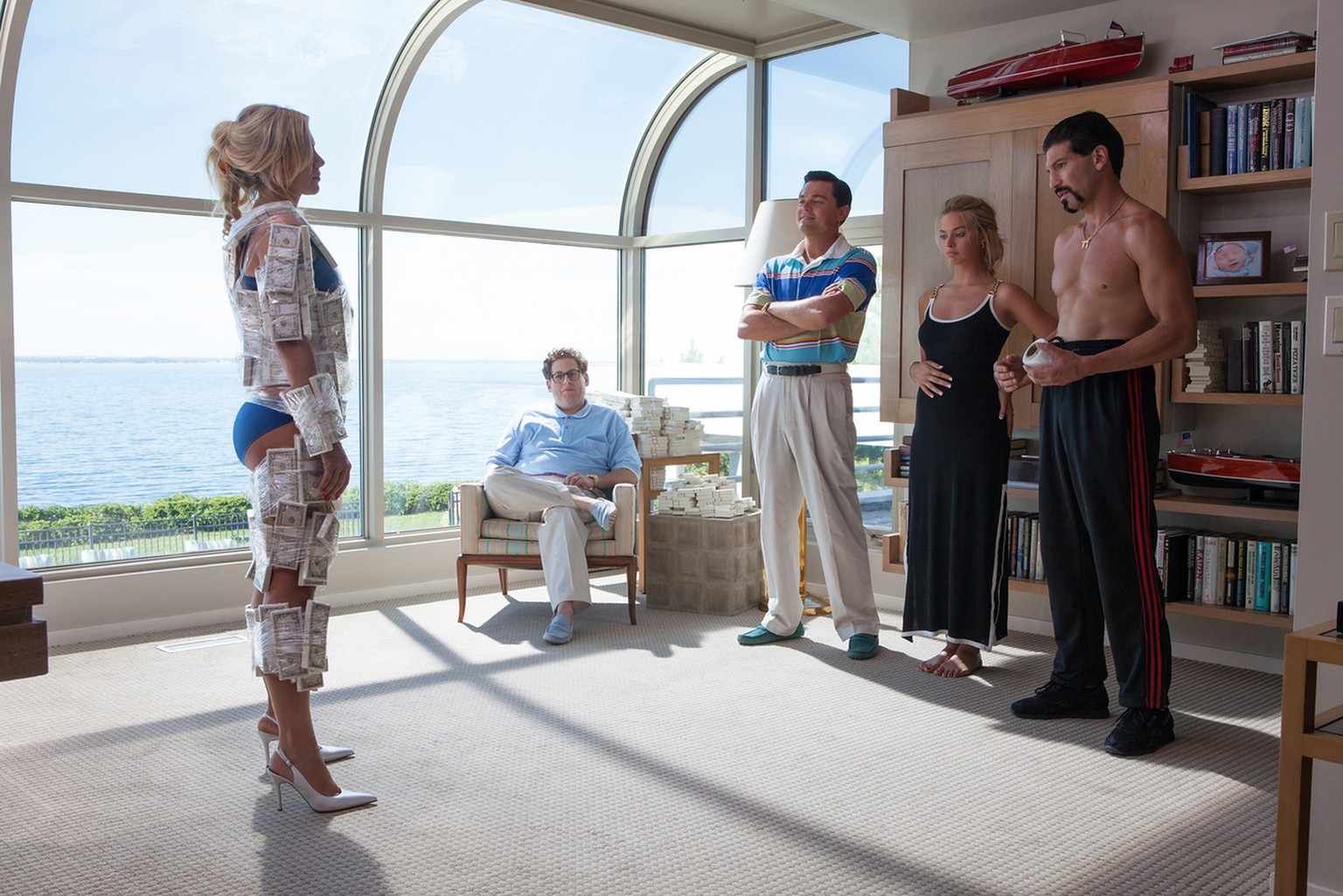 This image released by Paramount shows, from left, Katarina Cas, Jonah Hill, Leonardo DiCaprio, Margot Robbie and Jon Bernthal in a scene from