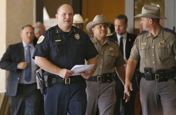 Odessa Police Chief Michael Gerke, left, arrives for a news conference with other officials Monday, Sept. 2, 2019, in Odessa, Texas. The gunman in a spate of violence after a traffic stop in West Texas had just been fired from his job and called both police and the FBI before the shooting began, authorities said. (AP Photo/Sue Ogrocki) Michael Gerke