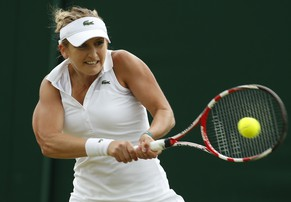 Timea Bacsinszky of Switzerland returns against Sharon Fichman of Canada during their first round match at the All England Lawn Tennis Championships in Wimbledon, London, Tuesday, June 24, 2014. (AP Photo/Alastair Grant)