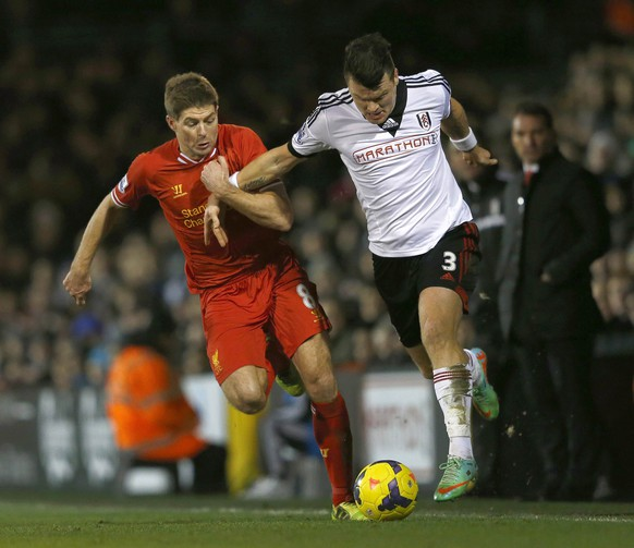 """Fulham's John Arne Riise (R) is challenged by Liverpool's Steven Gerrard during their English Premier League soccer match at Craven Cottage in London February 12, 2014.   REUTERS/Eddie Keogh (BRITAIN - Tags: SPORT SOCCER) NO USE WITH UNAUTHORIZED AUDIO, VIDEO, DATA, FIXTURE LISTS, CLUB/LEAGUE LOGOS OR """"LIVE"""" SERVICES. ONLINE IN-MATCH USE LIMITED TO 45 IMAGES, NO VIDEO EMULATION. NO USE IN BETTING, GAMES OR SINGLE CLUB/LEAGUE/PLAYER PUBLICATIONS. FOR EDITORIAL USE ONLY. NOT FOR SALE FOR MARKETING OR ADVERTISING CAMPAIGNS"""
