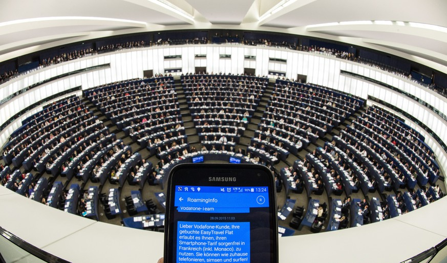 epa04998455 A hand holds a mobile phone showing SMS roaming information in the European Parliament in Strasbourg, France, 27 October 2015. Members of the European Parliament were voting on whether to scrap data roaming charges within the EU for mobile phone users.  EPA/PATRICK SEEGER