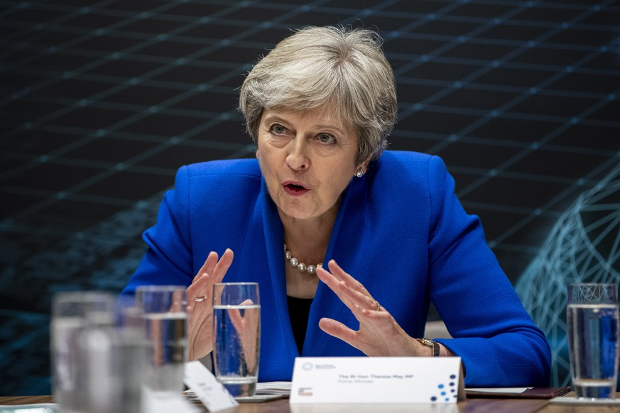 epa07012862 British Prime Minister Theresa May hosts a round table with business leaders at the Zero Emission Vehicle Summit in Birmingham, Britain, 11 September 2018. The summit will be attended by political leaders and representatives from industry in the aim of creating further development in the zero emissions vehicle market. Prime Minister May attends the summit whilst the UK's exit from the European Union (EU) continues to be negotiated.  EPA/WILL OLIVER