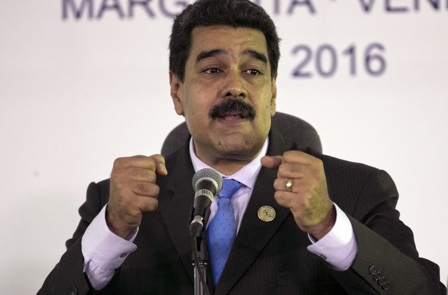 FILE - In this Sept 18, 2016, file photo, Venezuela's President Nicolas Maduro speaks during a press conference after closing ceremony of the 17th Non-Aligned Movement Summit in Porlamar, on Venezuela's Margarita Island. In Venezuela two-thirds of voters say in polls they want President Nicolas Maduro gone amid worsening shortages and inflation. (AP Photo/Ariana Cubillos, File)