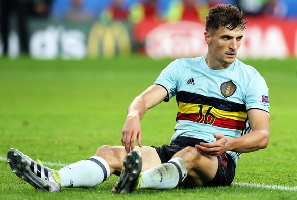 epa05402169 Belgium's Thomas Meunier reacts during the UEFA EURO 2016 quarter final match between Wales and Belgium at Stade Pierre Mauroy in Lille Metropole, France, 01 July 2016.(RESTRICTIONS APPLY: For editorial news reporting purposes only. Not used for commercial or marketing purposes without prior written approval of UEFA. Images must appear as still images and must not emulate match action video footage. Photographs published in online publications (whether via the Internet or otherwise) shall have an interval of at least 20 seconds between the posting.)  EPA/LAURENT DUBRULE   EDITORIAL USE ONLY