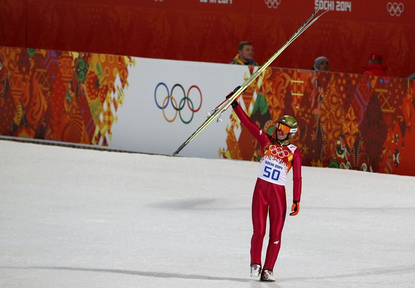 Winner Poland's Kamil Stoch celebrates after his victory in the men's ski jumping large hill individual final of the Sochi 2014 Winter Olympic Games, at the RusSki Gorki Ski Jumping Center in Rosa Khutor, February 15, 2014.                    REUTERS/Dominic Ebenbichler (RUSSIA  - Tags: OLYMPICS SPORT SKIING)