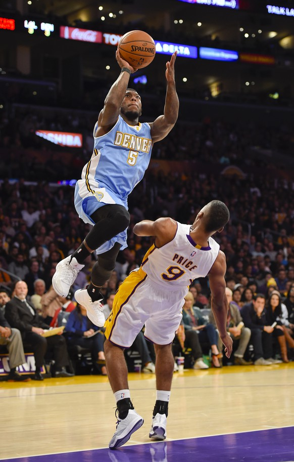Denver Nuggets guard Nate Robinson (5) drives on Los Angeles Lakers guard Ronnie Price (9) as he drives to the basket in the second half of an NBA basketball game, Sunday, Nov. 23, 2014, in Los Angeles. The Nuggets won 101-94.(AP Photo/Gus Ruelas)