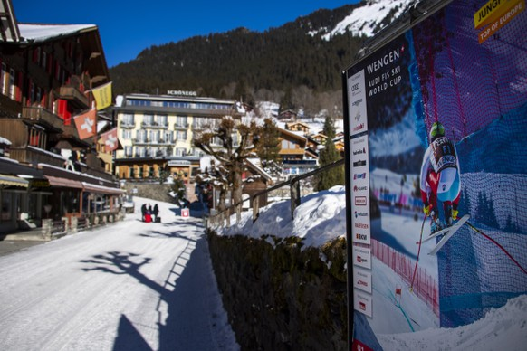 epa08931741 An advertising poster for the ski races is pictured in the street of the mountain village during the Coronavirus disease (Covid-19), in Wengen, Switzerland, Monday, January 11, 2021. The FIS Ski World Cup races in the Swiss resort of Wengen scheduled for 15th-17th January 2021 are been cancelled due to 'the current circumstances with the Covid-19 pandemic' as communicated by the organisers, SwissSki. The races, announced the International Ski Federation (FIS) would take place in Kitzbuhel, Austria.  EPA/JEAN-CHRISTOPHE BOTT