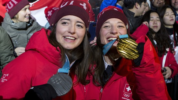 Silver medal winner Mathilde Gremaud of Switzerland, left, and Gold medal winner Sarah Hoefflin of Switzerland, right, celebrate at the House of Switzerland after the women Freestyle Skiing Slopestyle final during the XXIII Winter Olympics 2018 in Pyeongchang, South Korea, on Saturday, February 17, 2018. (KEYSTONE/Alexandra Wey)