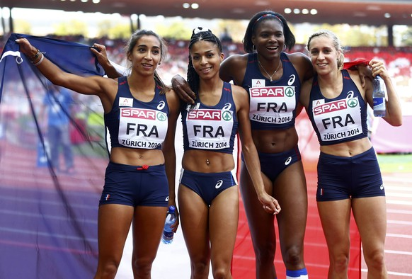 France's relay team Agnes Raharolahy, Floria Guei, Muriel Hurtis and Marie Gayot (L-R) celebrate after winning the women's 4 x 400 metres final during the European Athletics Championships at the Letzigrund Stadium in Zurich August 17, 2014.               REUTERS/Arnd Wiegmann (SWITZERLAND  - Tags: SPORT ATHLETICS)
