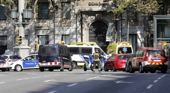 epa06148624 Mossos d'Esquadra Police officers and emergency service workers set up a security perimeter near the site where a van crashes into pedestrians in Las Ramblas, downtown Barcelona, Spain, 17 August 2017. According to initial reports a van crashed into a crowd in Barcelona's famous Placa Catalunya square at Las Ramblas area injuring several. Local media report the van driver ran away, metro and train stations were closed. The number of people injured and the reasons behind the incident are not yet known. Official sources have not confirmed that the incident is a terrorist attack.  EPA/Quique Garcia