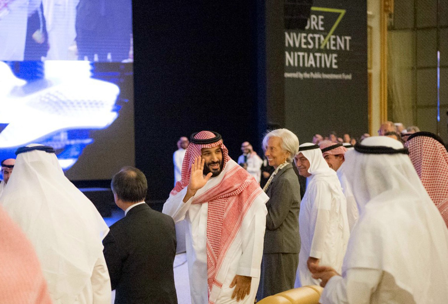 "In this photo released by Saudi Press Agency, SPA, Saudi Crown Prince Mohammed bin Salman, center left, and Managing Director of International Monetary Fund Christine Lagarde, center right, attend the opening ceremony of Future Investment Initiative Conference in Riyadh, Saudi Arabia, Tuesday, Oct. 24, 2017. Saudi Arabia's powerful crown prince on Tuesday announced plans to build a futuristic city run entirely on alternative sources of energy and said the ultraconservative kingdom must return to ""moderate Islam."