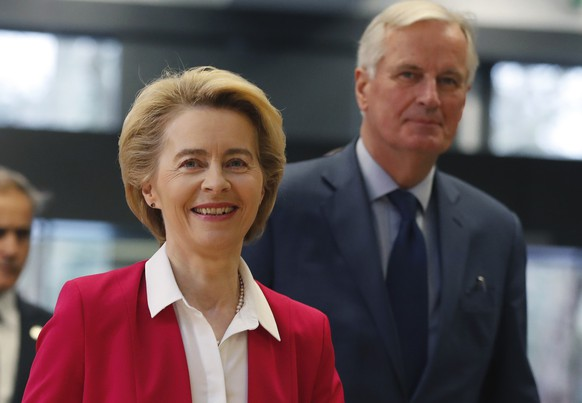 "European Commission President Ursula Von der Leyen and European Commission's Head of Task Force for Relations with the United Kingdom Michel Barnier arrive at the London School of Economics in London, Wednesday, Jan. 8, 2020. The European Commission's president warned Britain on Wednesday that it won't get the ""highest quality access"" to the European Union's market after Brexit unless it makes major compromises. (AP Photo/Frank Augstein)"